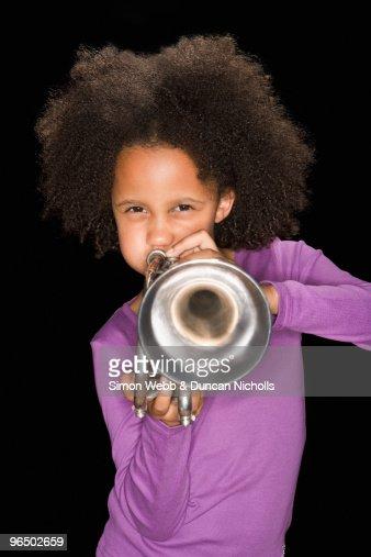 Girl playing trumpet : Stock Photo