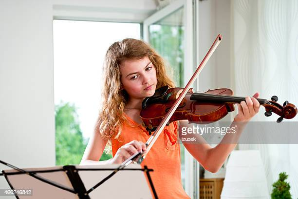Girl playing violin at home