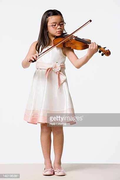 Girl (8-9) playing violin, studio shot