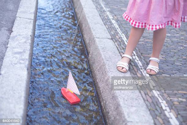 Girl playing with a boat