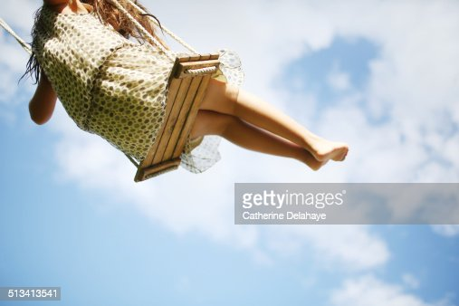 A girl playing with a swing