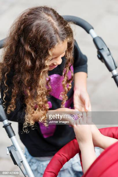 Girl playing with babys feet