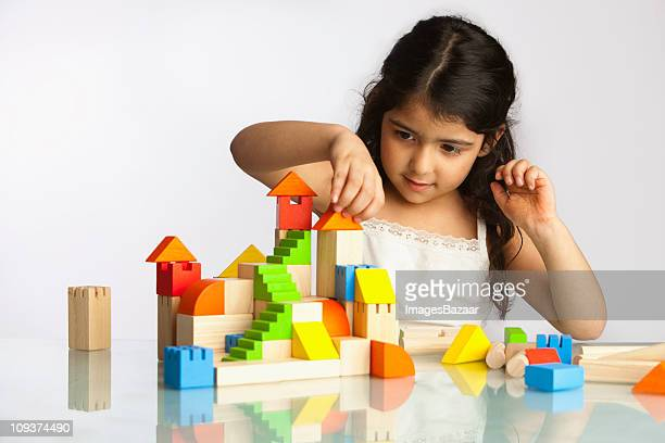 Girl (4-5) playing with building blocks
