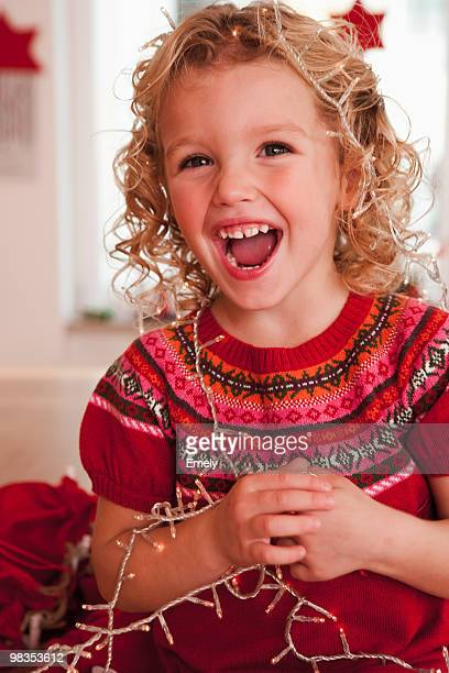 girl playing with christmas decoration
