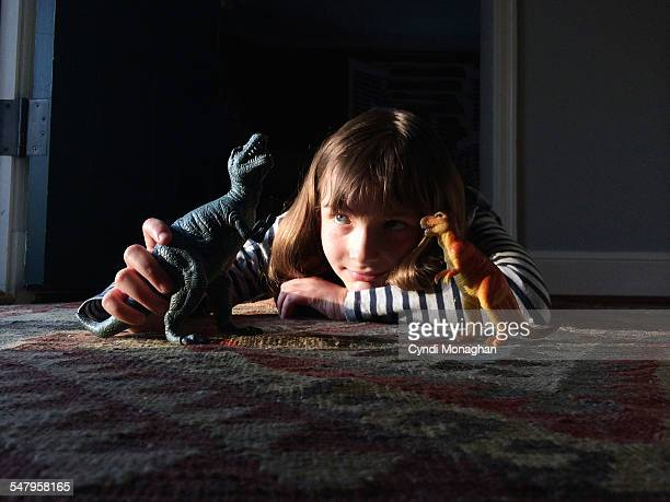 Girl Playing with Dinosaurs