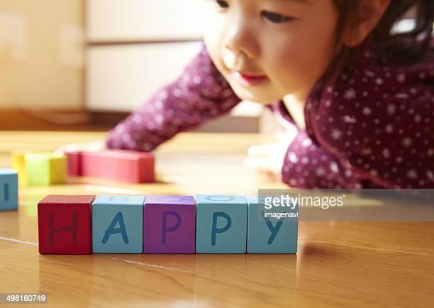 Girl playing with English blocks, Saitama, Japan