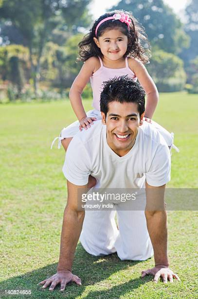 Girl playing with her father, Gurgaon, Haryana, India