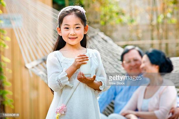 Girl playing with her grandparents