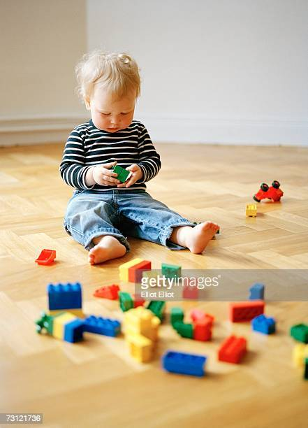 A girl playing with Lego.