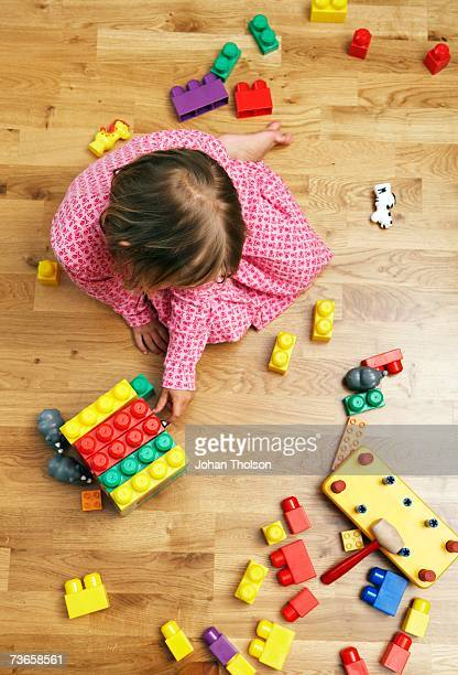 Girl playing with lego.