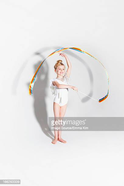 Girl playing with ribbon streamers