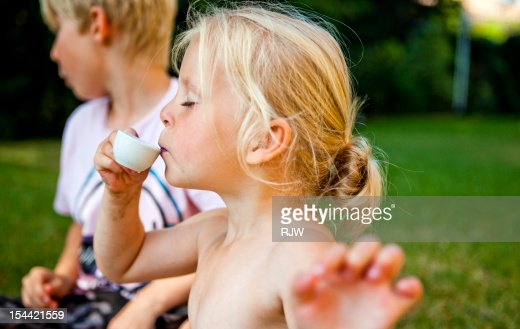 Girl Playing with Tea Set : Stock-Foto