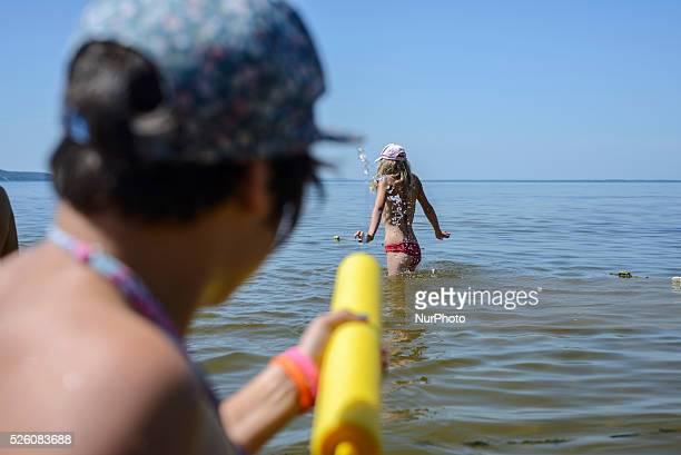 Girl playing with water gun in Ukrainian scout training camp Kiev region Ukraine