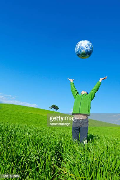 Girl playing with world globe