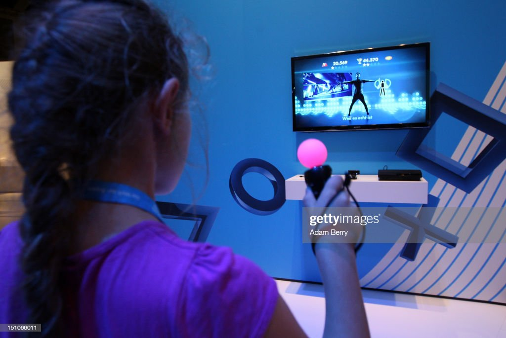 A girl plays a dancing game on a Playstation 3 (PS3) video console during the Internationale Funkausstellung (IFA) 2012 consumer electronics trade fair on August 31, 2012 in Berlin, Germany. Microsoft, Samsung, Sony, Panasonic and Philips are amongst many of the brands showcasing their latest consumer electronics hardware, software and gadgets to members of the public from August 31 to September 5.