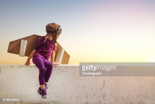 girl plays astronaut : Stock Photo