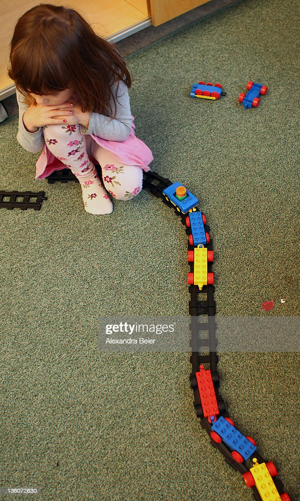 A girl plays at a day care center for children aged 12 months to six years on December 22, 2011 in Munich, Germany. German authorities claim the country will need to increase the capacity of its child day care centers by at least an additional 230,000 by 2013.