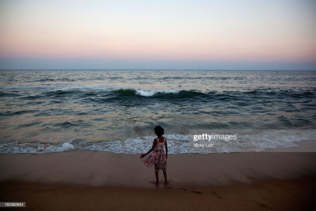 A girl plays during sunset at the Marina Beach on February 24, 2013 in Chennai, India. Marina Beach is an urban beach along the Bay of Bengal, which is part of the Indian Ocean. The beach runs a distance of 13km (8.1 miles), making it the longest natural urban beach in the country and the world's second longest.