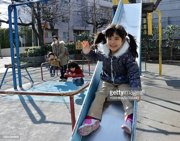 A girl plays on a playground slide at a park in Tokyo on March 2 2013 Intolerance of children and the noise they make is growing in Japan as fewer...