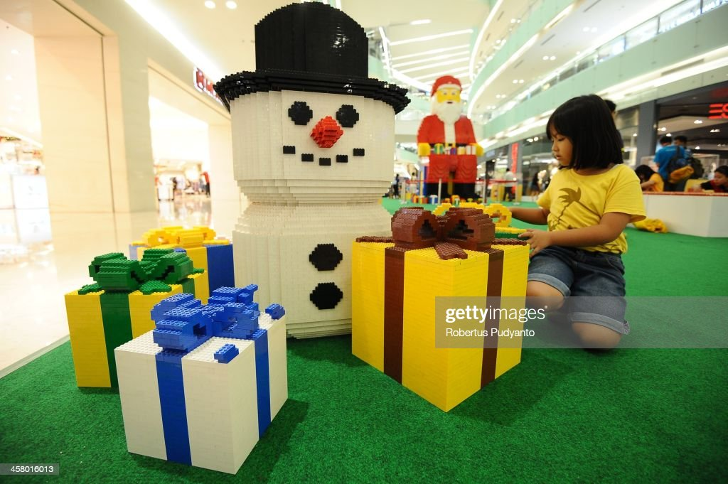 A girl plays Snowman LEGO bricks at Ciputra World Mall on December 19, 2013 in Surabaya, Indonesia. Indonesian Christians celebrate holiday season while on December 12, Indonesian police warned that Islamic extremists may be planning to target worshipers at Christmas and New Years celebrations in the capital Jakarta and other parts of the country.