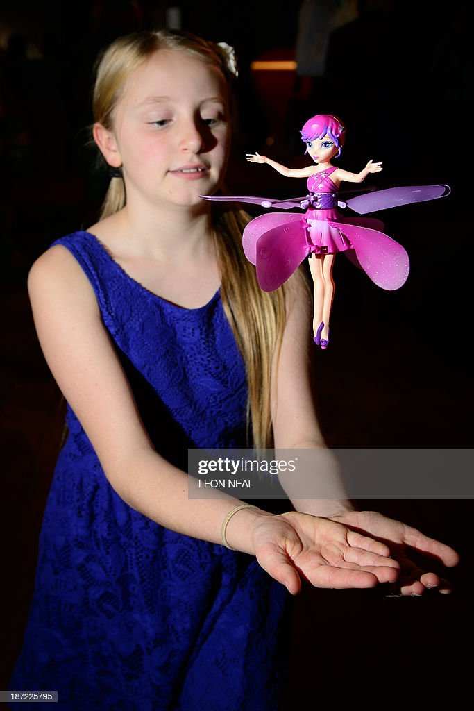 A girl plays with a flying fairy at the Dream Toys 2013 top ten preview event in London on November 6, 2013. The event sees manufacturers of the predicted Christmas bestsellers showcase their products in the run up to the festive season. AFP PHOTO / LEON NEAL