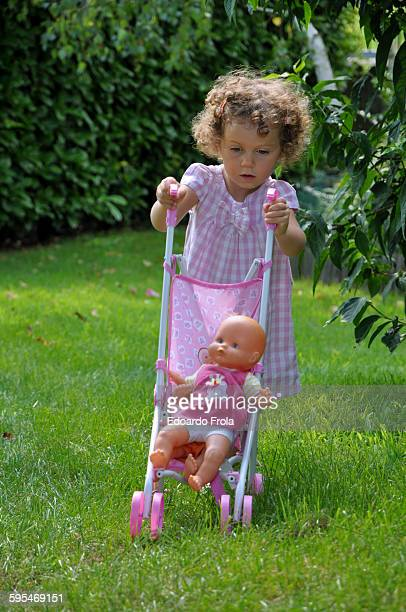 Girl plays with doll