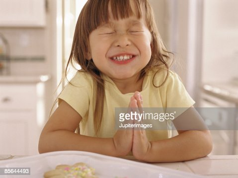 Girl pleading for a cookie : Stock Photo
