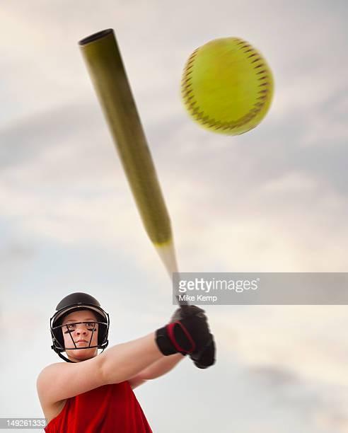 Girl (12-13) plying softball