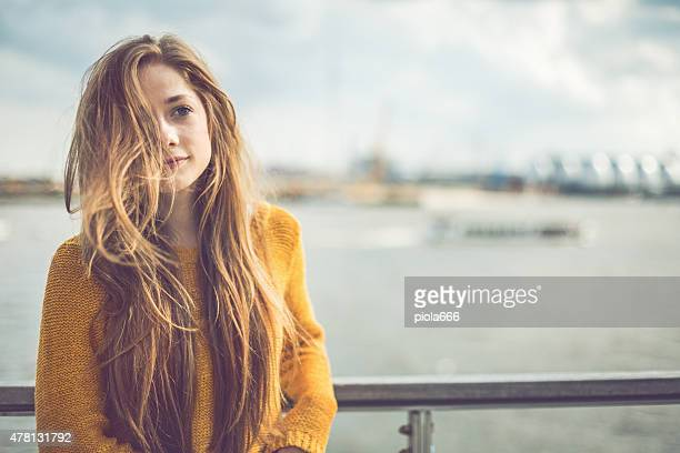 Girl portrait by the harbor