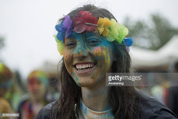 A girl poses at Color Run on April 30 2016 in Turin The Color Run is a noncompetitive event that takes place in Turin with music flowers and colors...