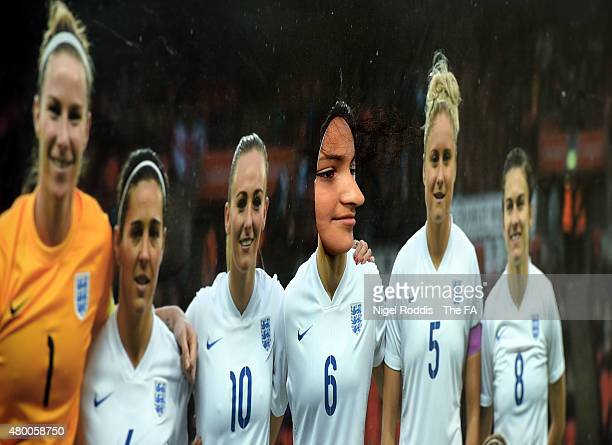 A girl poses for a photograph in a cut out of the England team during the FA Girls and West Riding County FA Football Festival on July 9 2015 in...