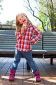 Girl posing eating frozen ice pop treat
