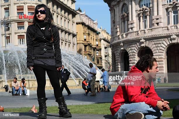 Girl posing for camera in Piazza de Ferrari.