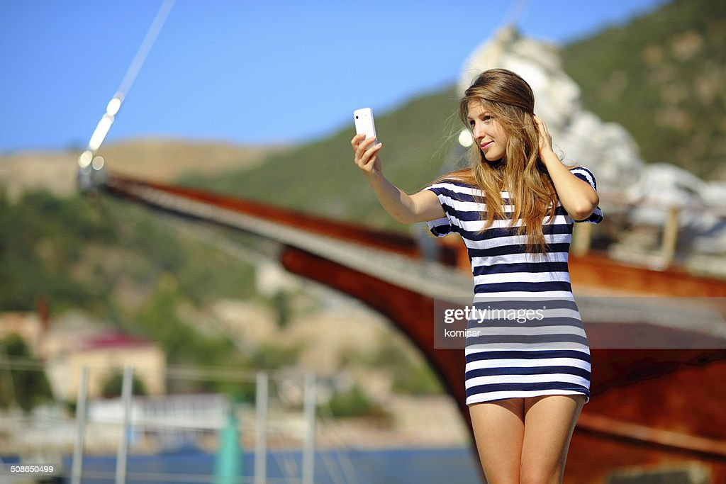 girl posing on a background of yachts : Stock Photo