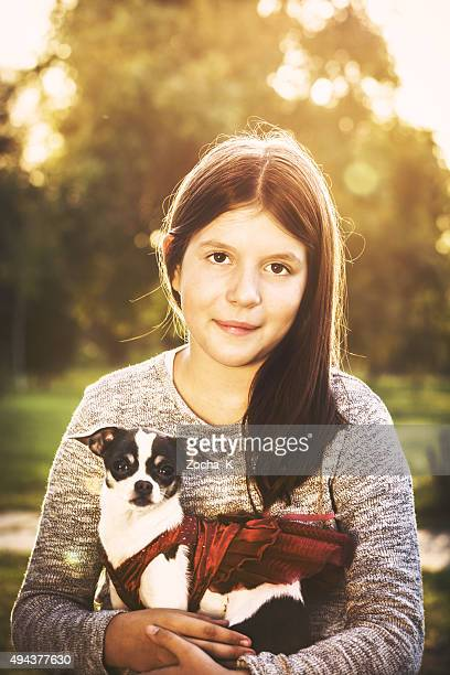 Girl posing with her dog - cute Chihuahua