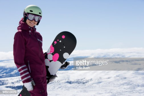 Girl posing with snowboard. : Stock Photo