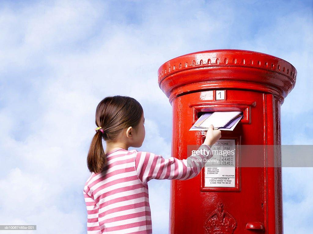 Girl (6-7) posting letter : Stock Photo