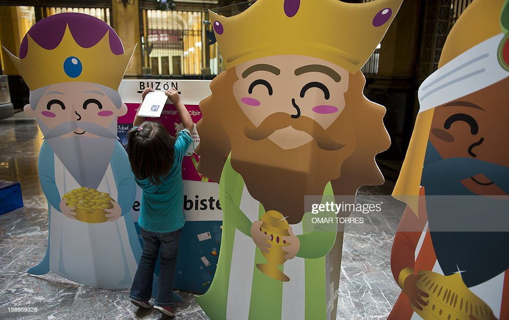A girl posts a letter to the Three Kings at the main post office in Mexico City on January 4, 2013. In Spanish-speaking parts of the world, children believe that the Three Kings receive their letters and so bring them gifts on the night before Epiphany. The Mexican Post Office opened this service to encourage the use of traditional mail.