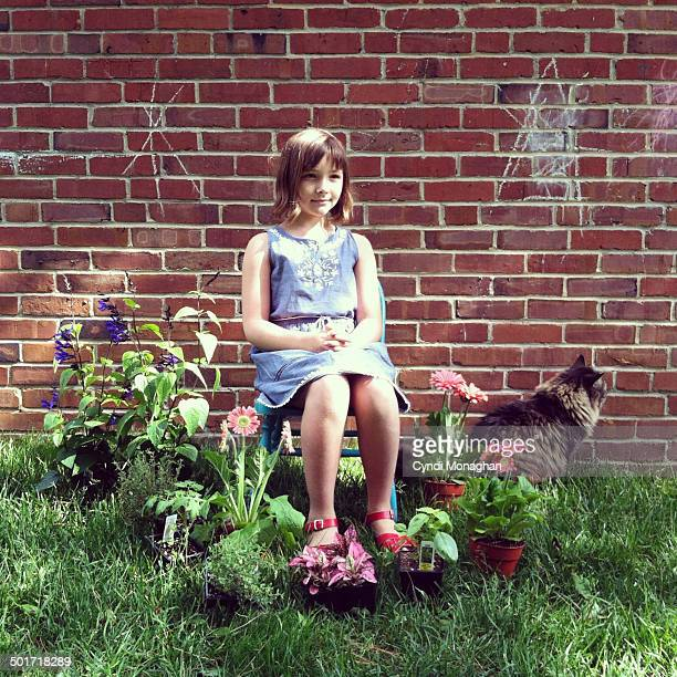 Girl, Potted Plants and Cat