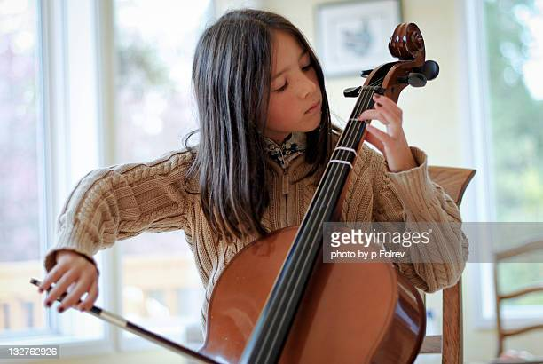 Girl practicing Cello at home