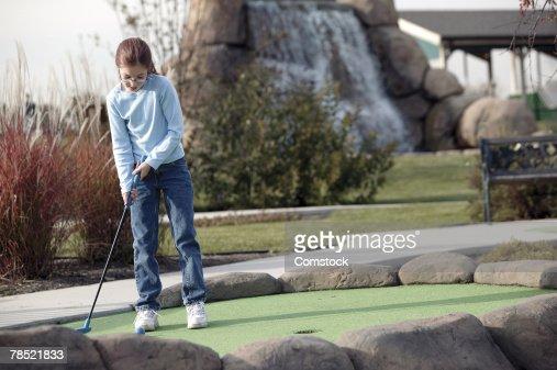 Girl practicing golf : Stock Photo
