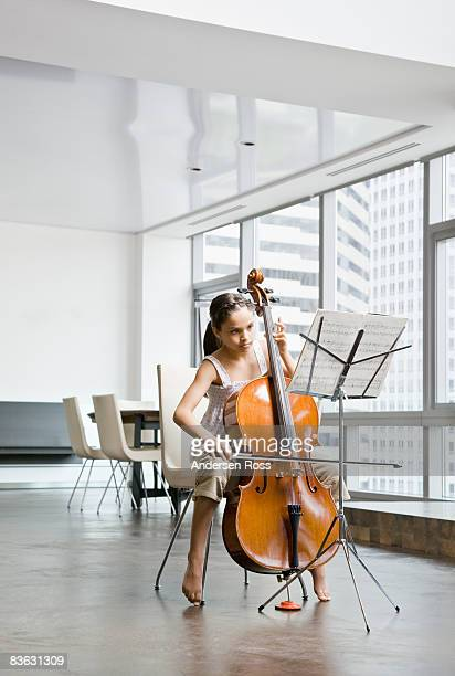 Girl practicing her cello