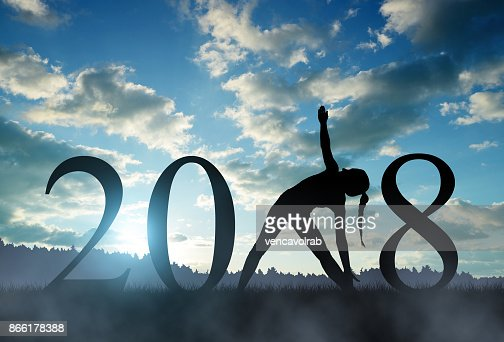 Girl practicing yoga in the New Year 2018. : Stock Photo