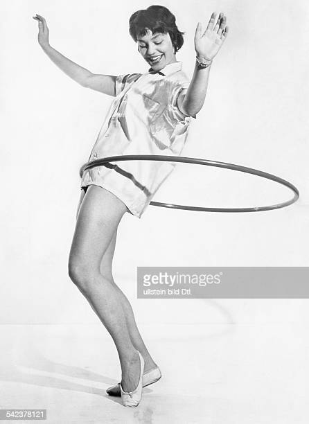 A girl practising with a hula hoop 1959