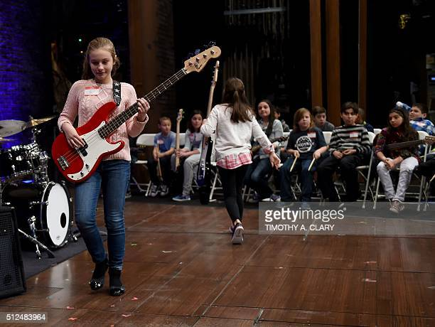 A girl prepares to play for show staff at the Winter Garden Theatre on February 26 2016 as the Broadway musical 'School of Rock' by Andrew Lloyd...