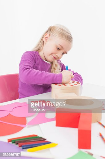 Girl preparing gift, smiling : Stock Photo