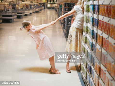 Girl Pulling Mothers Arm