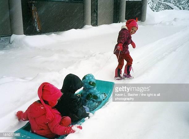 Girl pulling sled