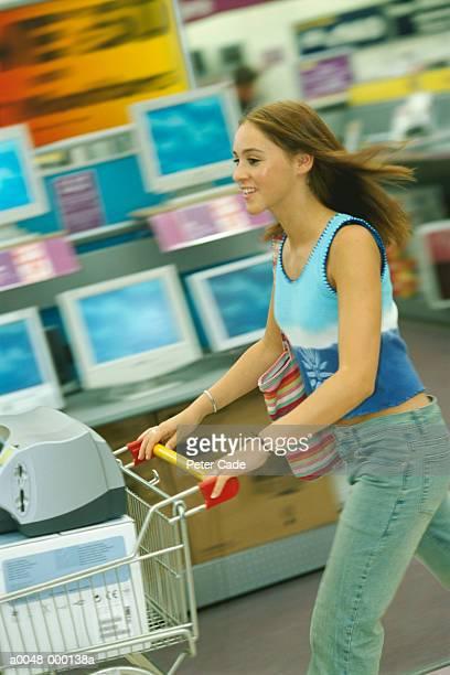 Girl Pushing Shopping Cart