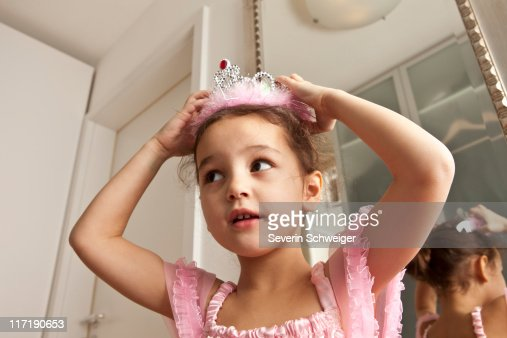 Girl putting crown on her head